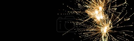Photo for Panoramic shot of yellow traditional fireworks in night sky, isolated on black - Royalty Free Image