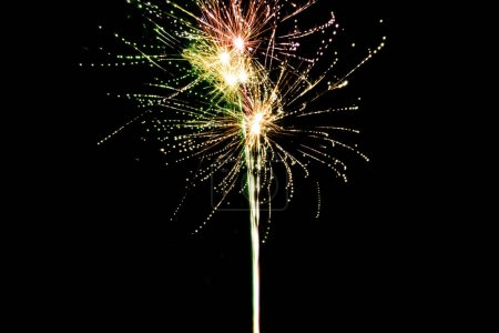 Photo for Red and green festive fireworks in night sky, isolated on black - Royalty Free Image