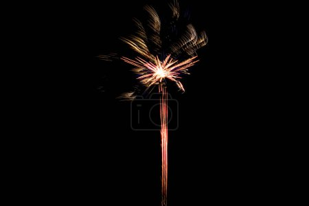 Photo pour Blurred firework in night sky, isolated on black - image libre de droit