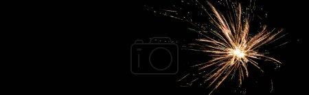 Photo for Panoramic shot of orange festive firework on party, isolated on black - Royalty Free Image