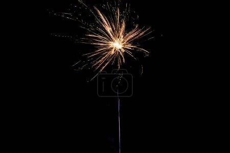 Photo for Orange firework on party, isolated on black - Royalty Free Image