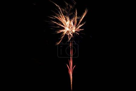 Photo pour Orange festive firework on party, isolated on black - image libre de droit
