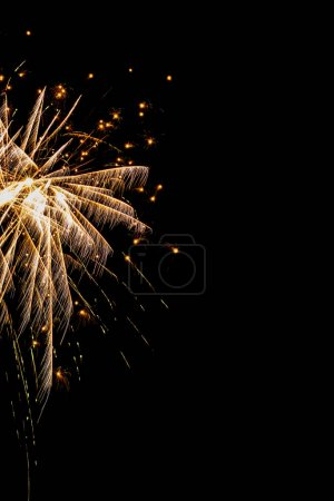 Photo for Golden festive fireworks on party, isolated on black - Royalty Free Image