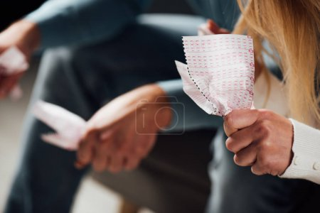 Photo for Cropped view of unhappy man and woman holding crumpled lottery tickets - Royalty Free Image