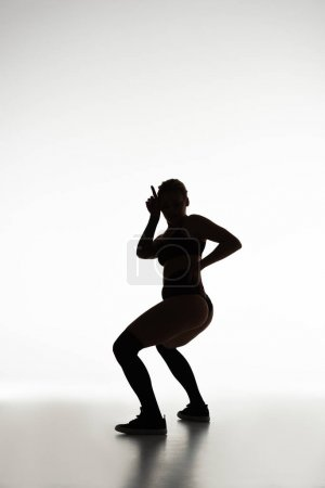 silhouette of sexy girl twerking isolated on white