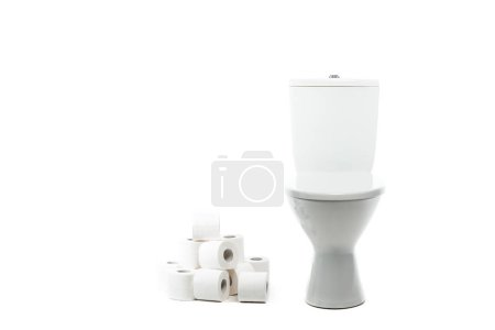 ceramic clean toilet bowl near rolls of toilet paper isolated on white