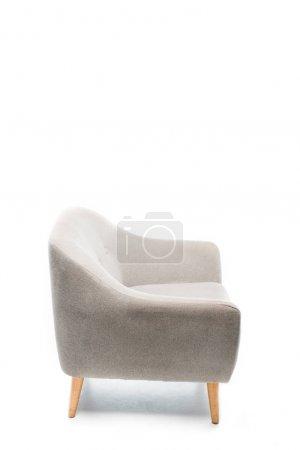 Foto de Confortable sillón gris moderno en blanco - Imagen libre de derechos