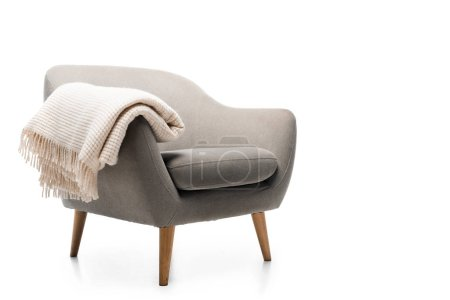 Photo for Comfortable grey modern armchair with blanket isolated on white - Royalty Free Image