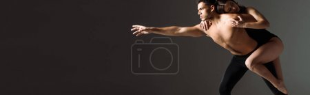 Photo for Panoramic shot of sexy dancers dancing contemporary isolated on black - Royalty Free Image