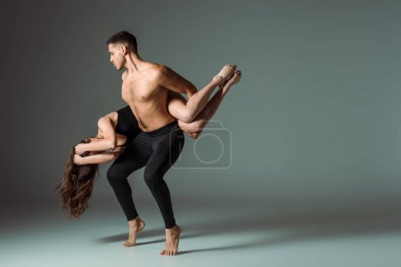 sexy dancers dancing contemporary on dark background with copy space