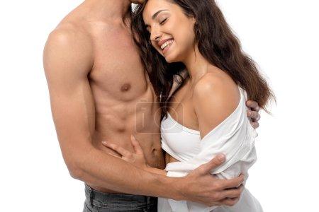 Photo pour Sexy couple souriant étreinte, isolé sur blanc - image libre de droit