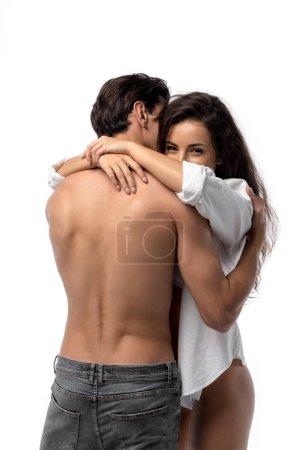 Photo pour Torse nu petit ami sexy étreignant petite amie heureuse, isolé sur blanc - image libre de droit