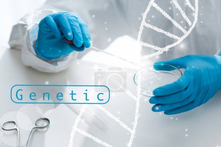 Photo for Cropped view of scientist doing dna test and sitting near dna illustration - Royalty Free Image