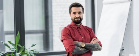 Photo for Panoramic shot of handsome and smiling account manager with crossed arms looking at camera - Royalty Free Image