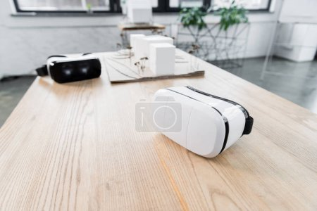 selective focus of virtual reality headset on wooden table