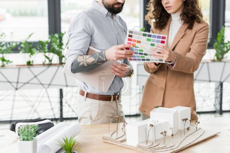 Photo for Cropped view of virtual reality architects looking at layout of colors - Royalty Free Image