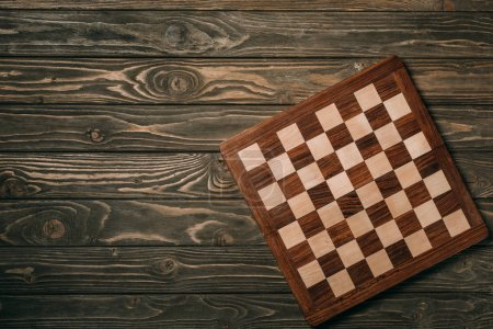 Photo for Top view of chessboard on wooden surface - Royalty Free Image