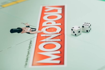 KYIV, UKRAINE - NOVEMBER 15, 2019: Selective focus of two dices on monopoly board game