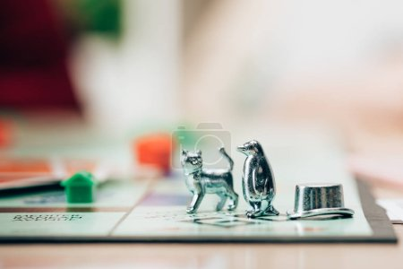 KYIV, UKRAINE - NOVEMBER 15, 2019: Selective focus of figures on monopoly board game