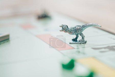 KYIV, UKRAINE - NOVEMBER 15, 2019: Selective focus of playing figure on monopoly game