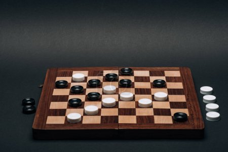 Photo for Checkerboard with black and white checkers isolated on black - Royalty Free Image