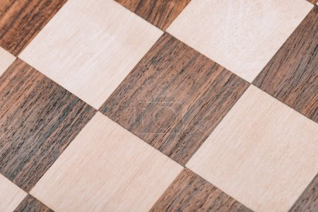 Photo for Close up view of surface of wooden checkerboard - Royalty Free Image