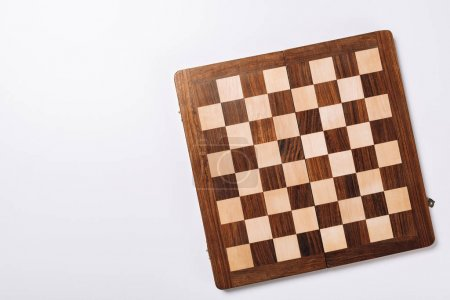 Photo for Top view of checkerboard on white background with copy space - Royalty Free Image