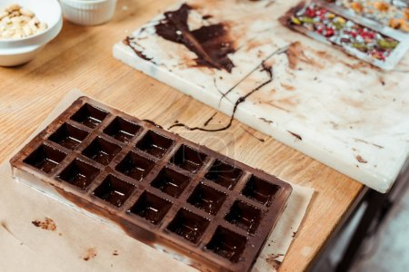 Photo for Selective focus of chocolate molds with melted chocolate - Royalty Free Image