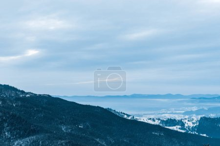 Photo for Scenic view of snowy mountains and cloudy sky - Royalty Free Image