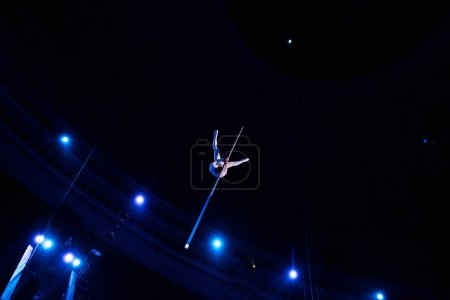 Photo for Low angle view of man balancing in arena of circus - Royalty Free Image