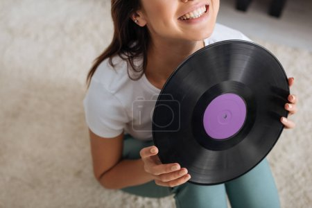 Photo for Cropped view of happy woman holding retro vinyl record - Royalty Free Image