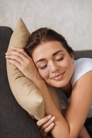 Photo for Smiling woman with closed eyes chilling while lying on pillow - Royalty Free Image