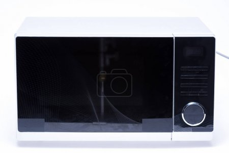 Photo for Metal and electrical microwave oven on white background - Royalty Free Image