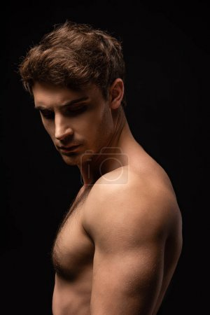 Photo pour Sexy man with bare muscular torso isolated on black - image libre de droit