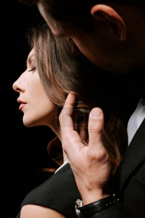 Photo for Cropped view of man touching attractive woman isolated on black - Royalty Free Image