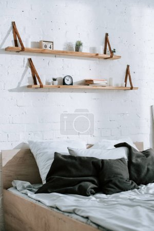 grey pillows on bed in modern bedroom