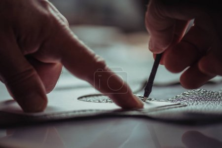 Photo for Cropped view of shoemaker marking leather with special pen near template - Royalty Free Image