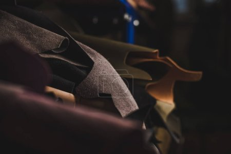 Photo for Selective focus of cut pieces of genuine leather in workshop - Royalty Free Image