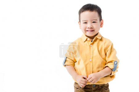 happy little asian boy isolated on white