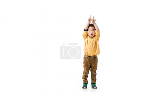 Photo for Shocked asian boy pointing up isolated on white - Royalty Free Image