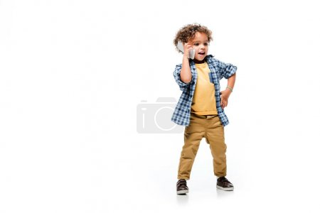 positive african american boy talking on smartphone, isolated on white