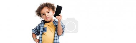 panoramic shot of pensive african american boy holding smartphone with blank screen, isolated on white