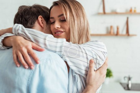 Photo for Selective focus of happy girl with closed eyes hugging boyfriend - Royalty Free Image