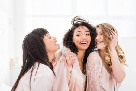 Photo for Happy multicultural girls in bathrobes hugging on bachelorette party - Royalty Free Image
