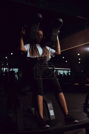 african american woman working out on gym machine