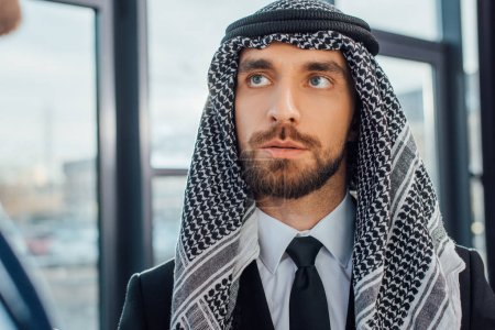 Photo for Arabic businessman looking at partner in office - Royalty Free Image