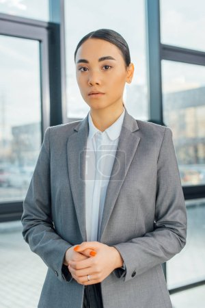 Photo for Beautiful asian businesswoman standing in modern office - Royalty Free Image