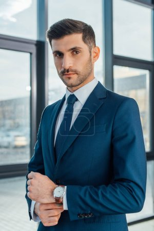 Photo for Handsome professional businessman in suit posing in modern office - Royalty Free Image