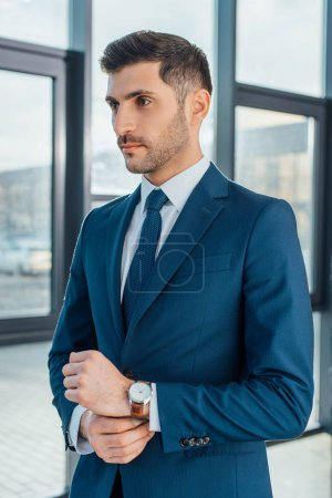 Photo for Professional businessman in suit standing in modern office - Royalty Free Image