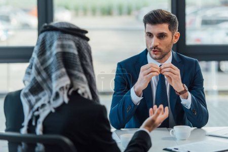 middle east businessman talking with partner on meeting in modern office